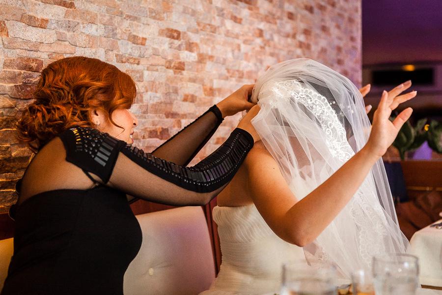 bride's friend fixes the veil