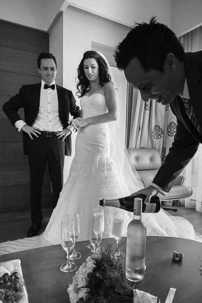 Groom's brother pouring champagne
