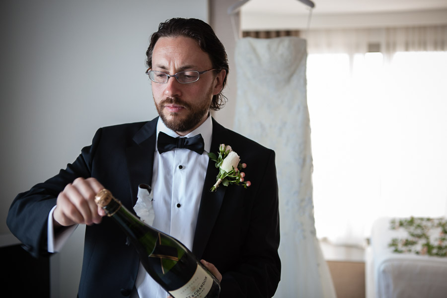 bodrum wedding groom opening champagne