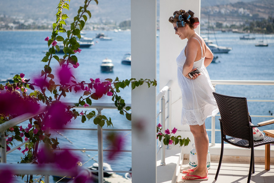 bride on the balcony before wearing the dress