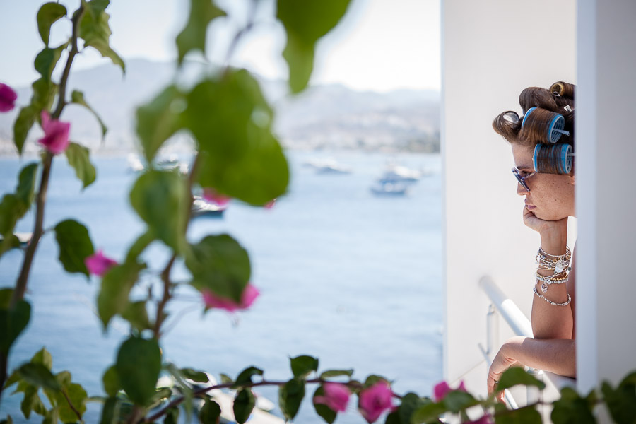 bride on balcony before getting ready