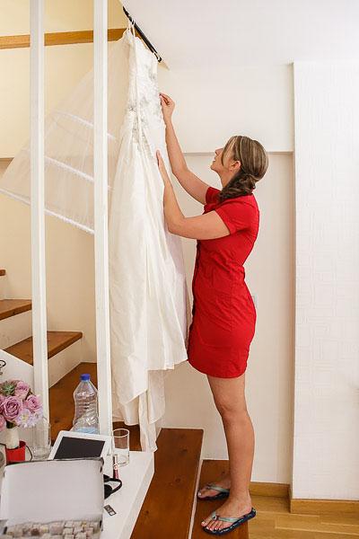 Bride hanging the wedding dress