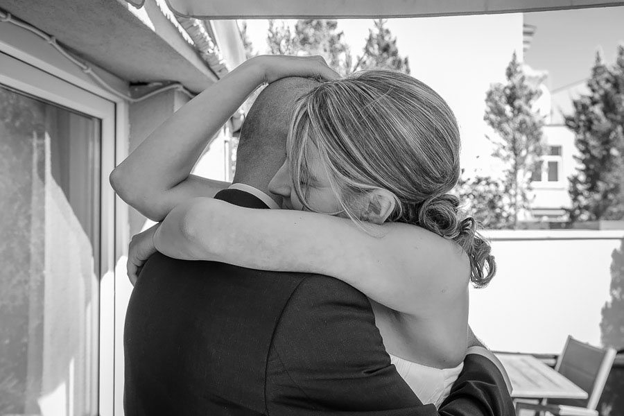 passionate hug during the first look