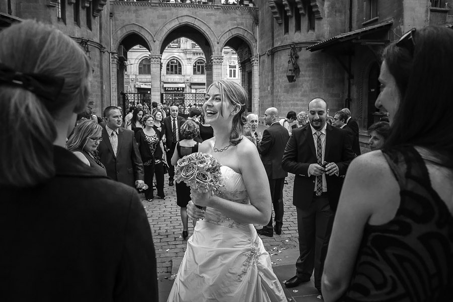 Bride laughing after st antoine church wedding