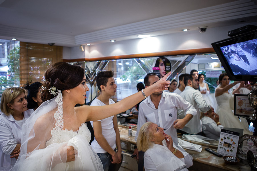bride pointing at the security footage of the theft that occured at hair dresser's
