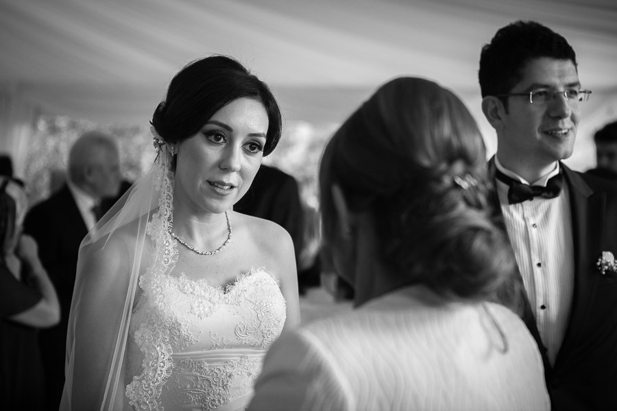bride welcoming the guests at the coctail