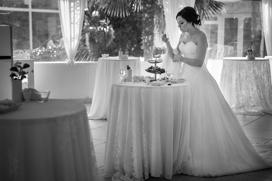 hungry bride feeding on the leftovers from the coctail