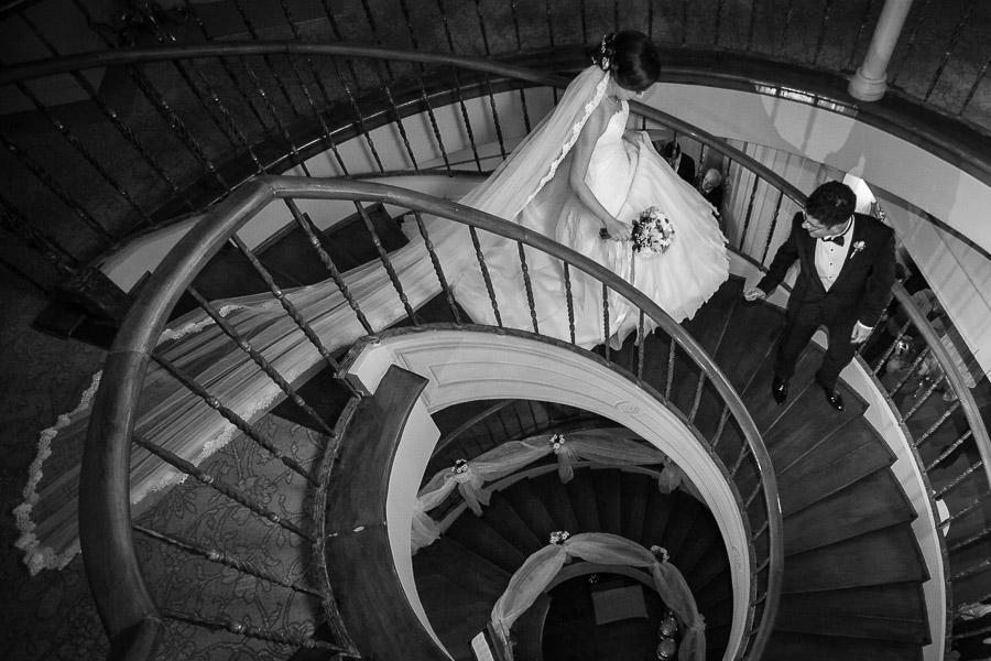 bride groom walking down stairs