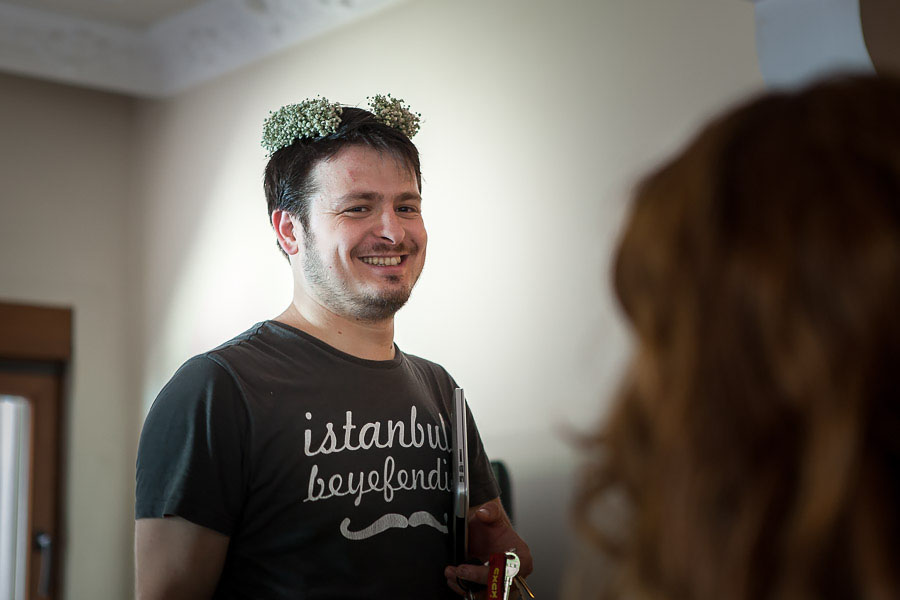 groom wearing bride's headpiece