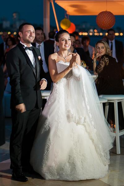 Bride and groom watch slideshow at Moda Deniz Kulubu wedding