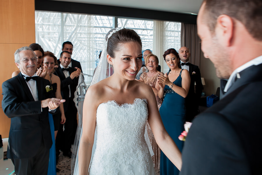 Bride and family during the first look at DoubleTree Hilton Moda wedding