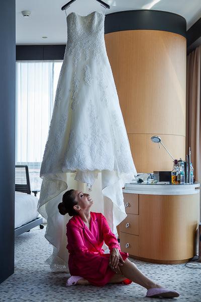 Bride sitting under the wedding dress