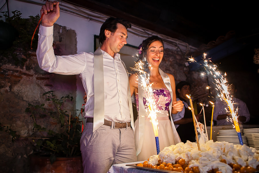 Bride-and-groom-to-be cutting their engagement cake at Giritli
