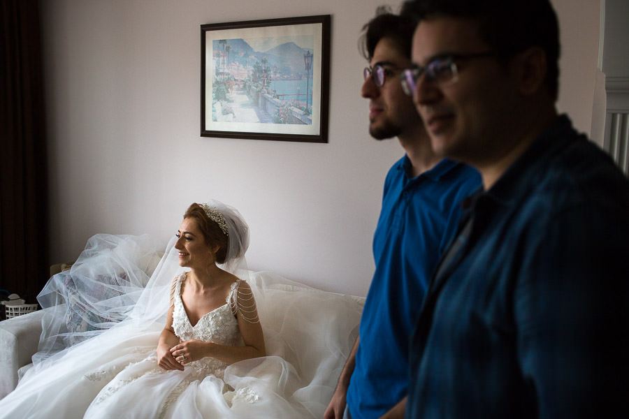 Bride sitting on couch while friends visiting