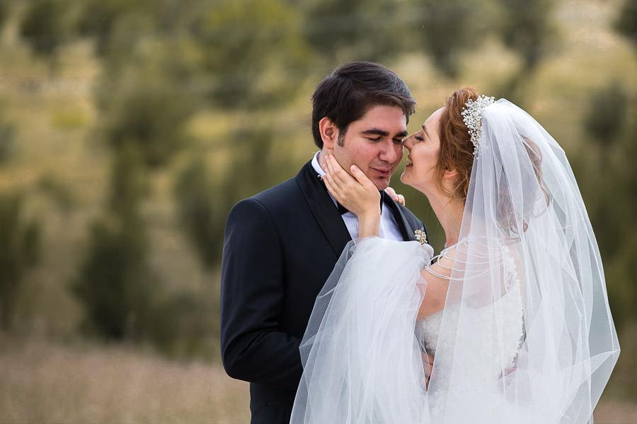 Bride kissing groom on thr cheek