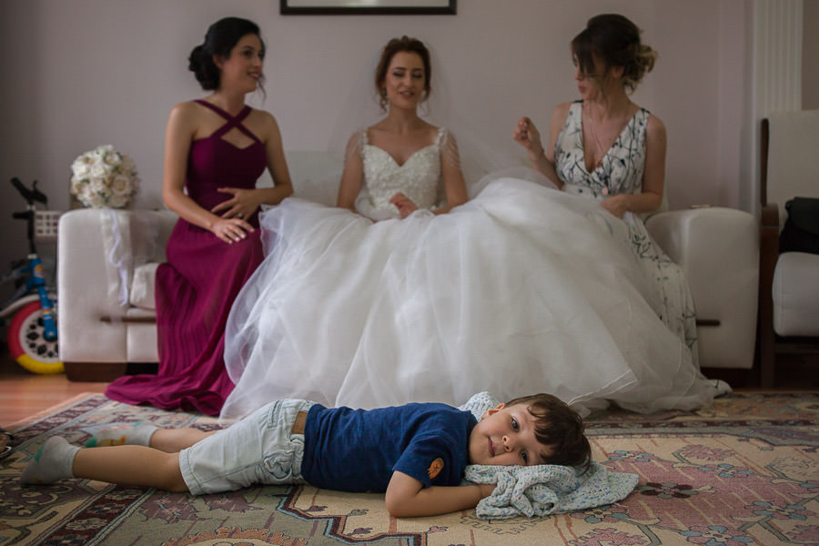boy lying in front of the bride