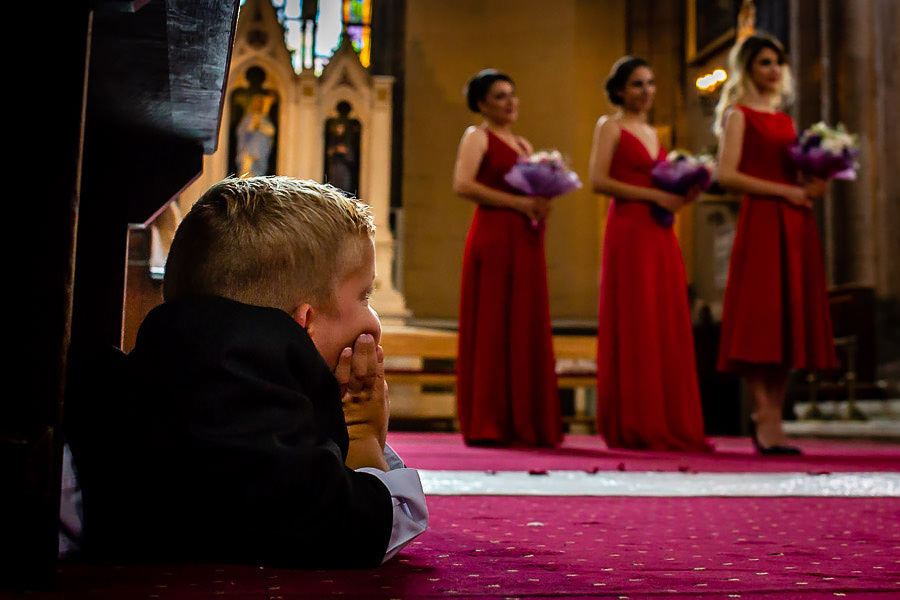ring bearer watching the bridesmaids at istanbul st. anthony of padua wedding