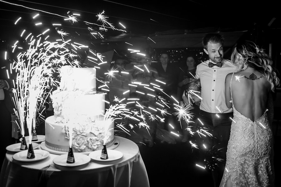 sparklers on wedding cake on a windy night