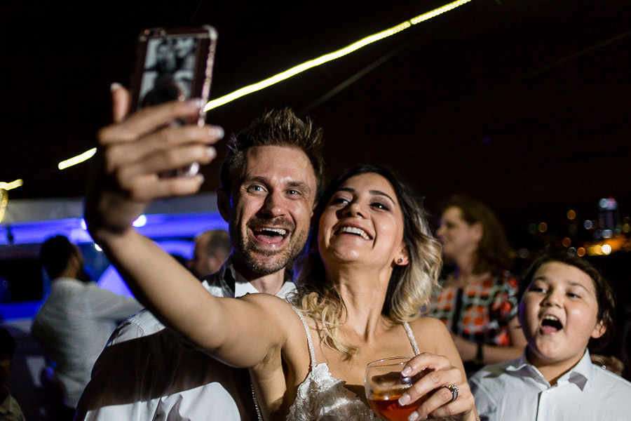 bride and groom taking selfie at reception