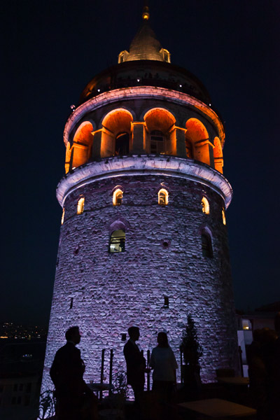 silhouettes against galata tower