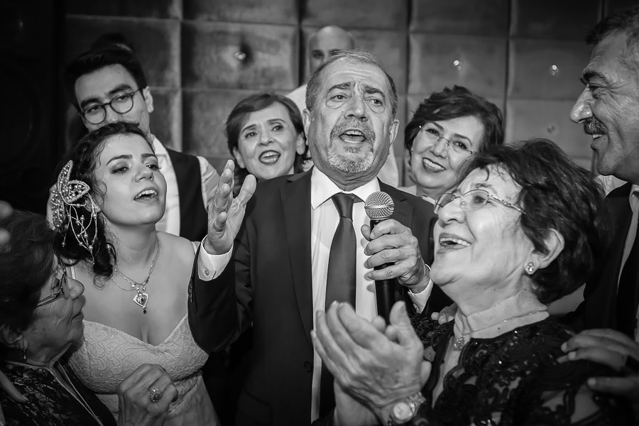 Bride's uncle singing at wedding