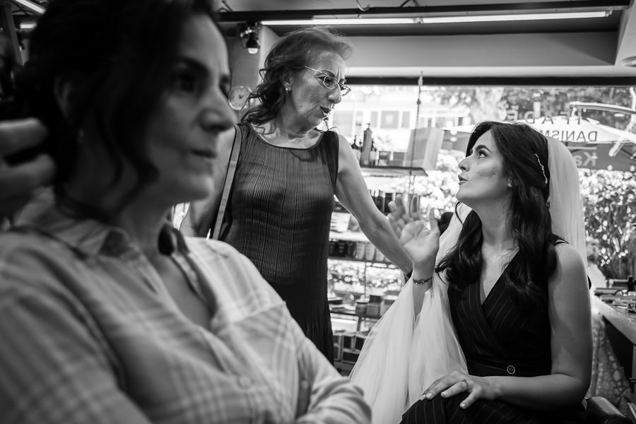 Bride speaking with mom at hair salon