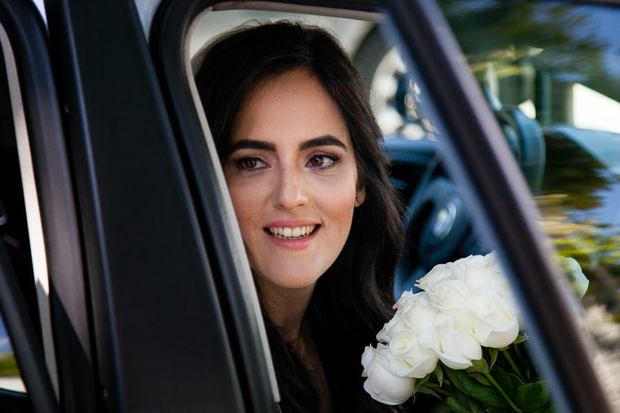 Bride looking out the car door