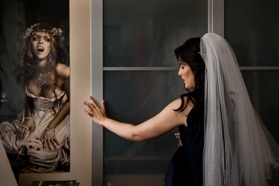 Bride shutting the dresser's door with fantasy bride poster on the wall