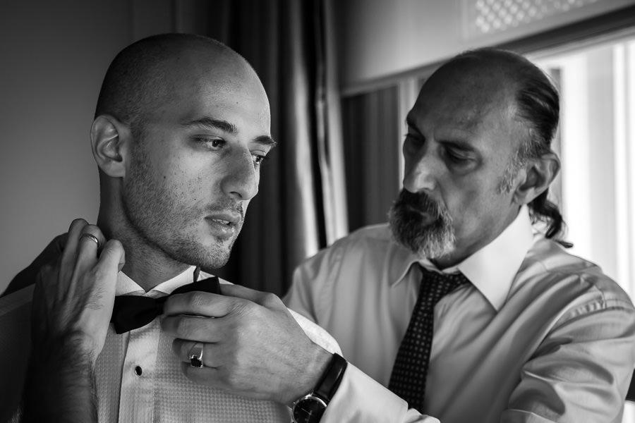 dad helps groom getting ready
