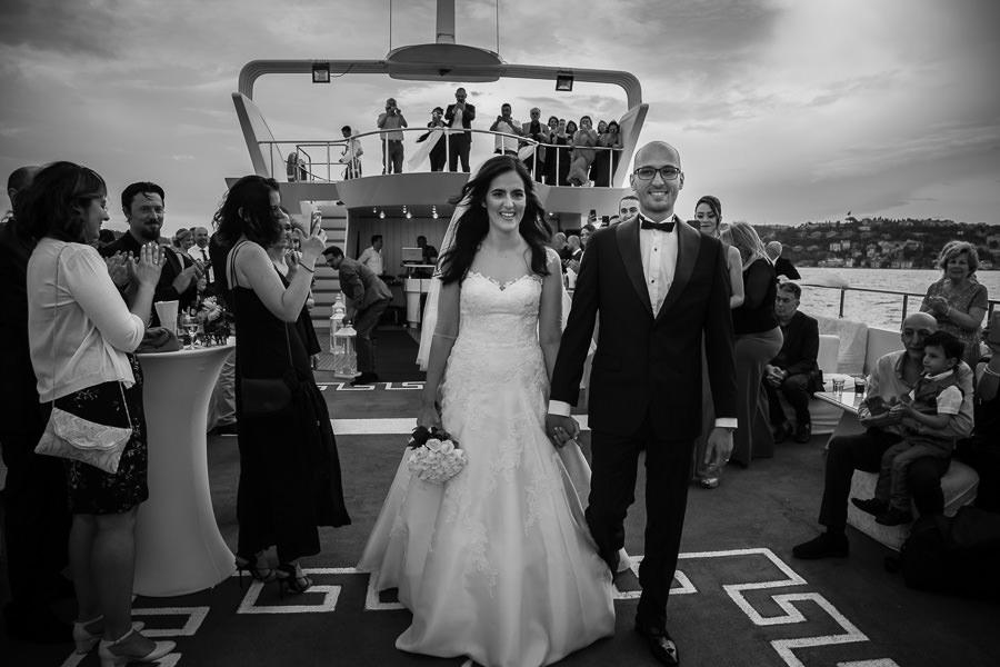 bride and groom walking through guests on the bosphorus